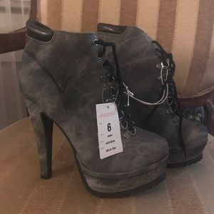 Gray high heeled Lace up boots